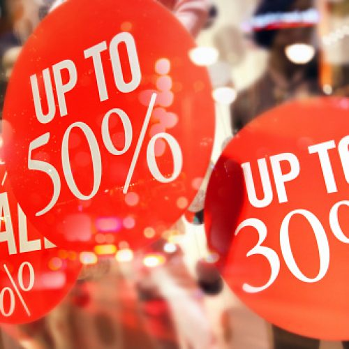 Shopping sales sign with percentage discount on price tag